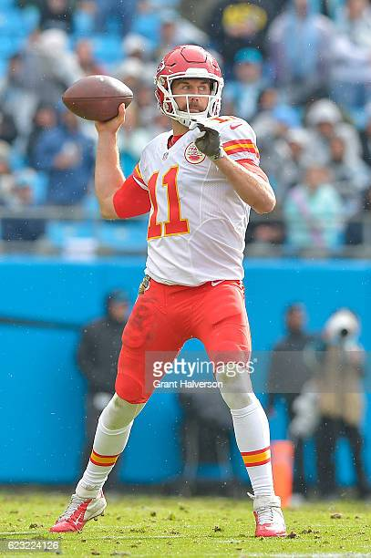 Alex Smith of the Kansas City Chiefs in action against the Carolina Panthers during the game at Bank of America Stadium on November 13 2016 in...