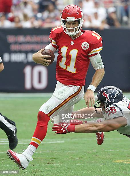 Alex Smith of the Kansas City Chiefs is chased by Brian Cushing of the Houston Texans in the second half in a NFL game on September 13 2015 at NRG...