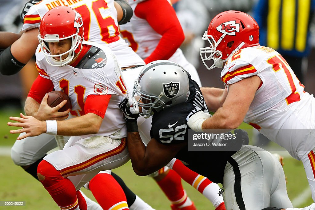 Alex Smith #11 of the Kansas City Chiefs is sacked by Khalil Mack #52 of the Oakland Raiders during their NFL game at O.co Coliseum on December 6, 2015 in Oakland, California.