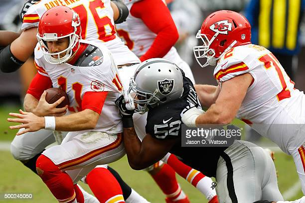 Alex Smith of the Kansas City Chiefs is sacked by Khalil Mack of the Oakland Raiders during their NFL game at Oco Coliseum on December 6 2015 in...