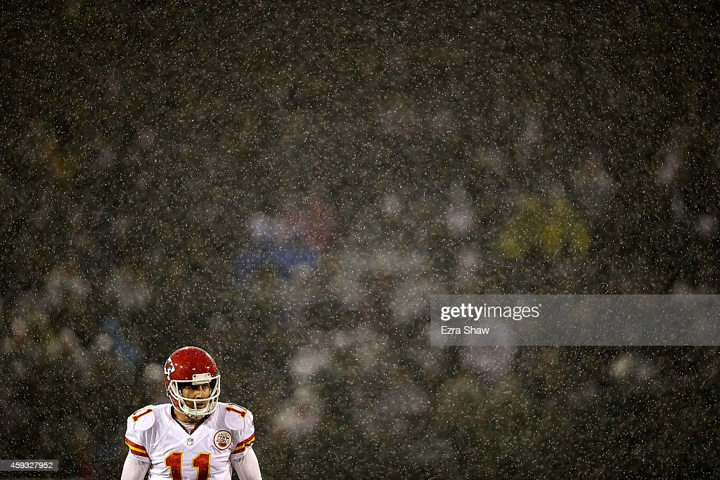 Alex Smith #11 of the Kansas City Chiefs looks on as downpour of rain falls during the game against the Oakland Raiders at O.co Coliseum on November 20, 2014 in Oakland, California.