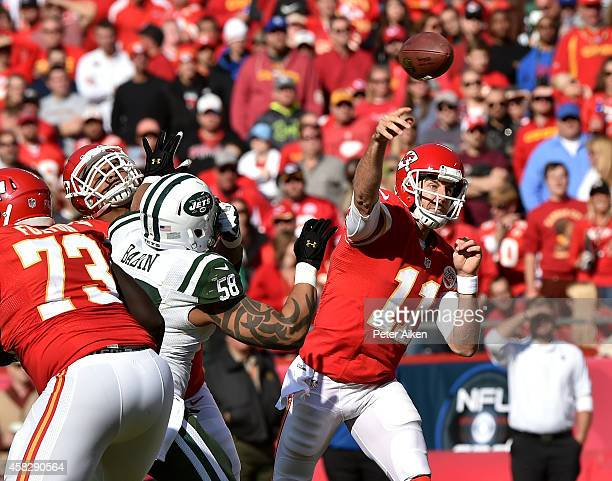 Alex Smith of the Kansas City Chiefs passes against Jason Babin of the New York Jets during the first half at Arrowhead Stadium on November 2 2014 in...