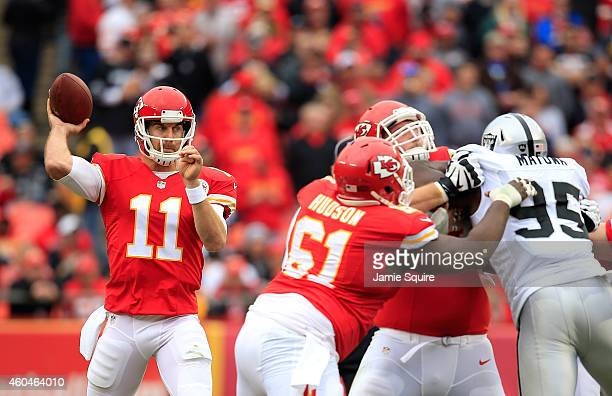 Alex Smith of the Kansas City Chiefs passes against the Oakland Raiders during the first half at Arrowhead Stadium on December 14 2014 in Kansas City...