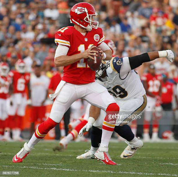 Alex Smith of the Kansas City Chiefs prepares to throw a pass down field during a preseason game against the Los Angeles Rams at the Los Angeles...