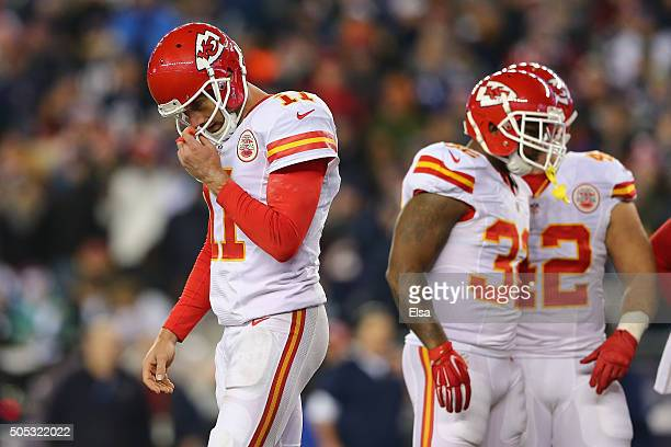 Alex Smith of the Kansas City Chiefs reacts in the second half against the New England Patriots during the AFC Divisional Playoff Game at Gillette...