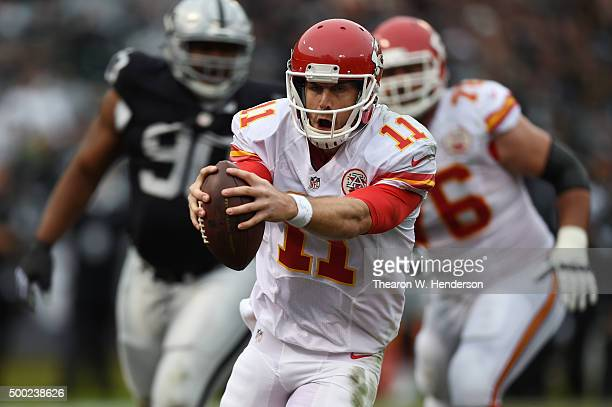 Alex Smith of the Kansas City Chiefs runs for a threeyard touchdown against the Oakland Raiders during their NFL game at Oco Coliseum on December 6...