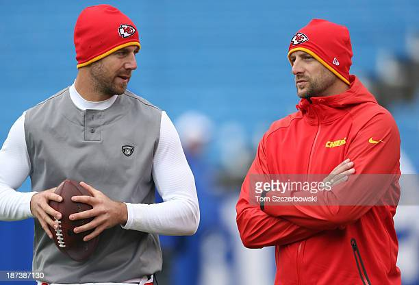Alex Smith of the Kansas City Chiefs talks to quarterbacks coach Matt Nagy as he warms up before NFL game action against the Buffalo Bills at Ralph...