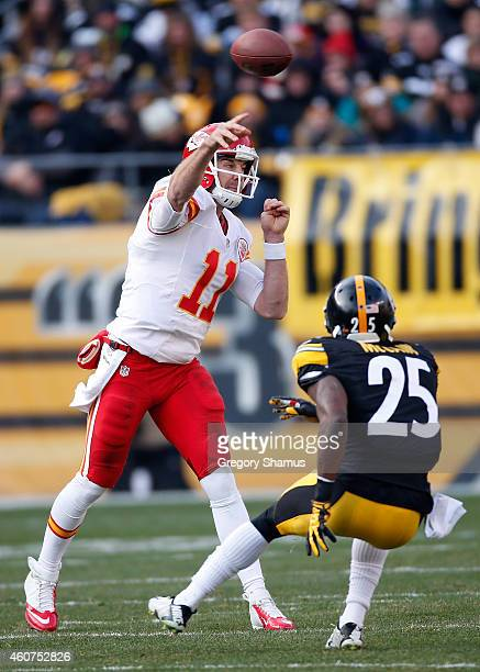 Alex Smith of the Kansas City Chiefs throws a pass in front of Brice McCain of the Pittsburgh Steelers during the third quarter at Heinz Field on...