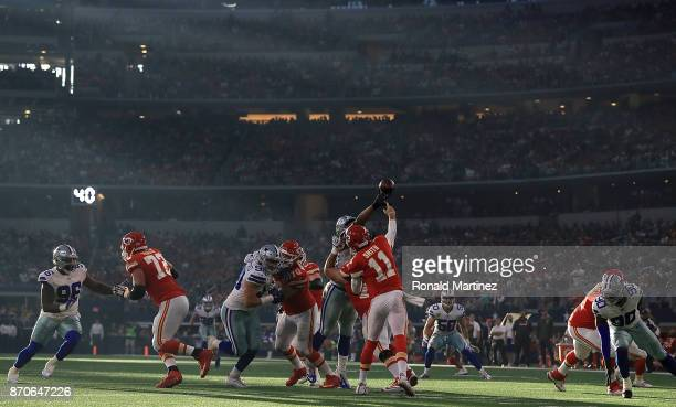 Alex Smith of the Kansas City Chiefs throws against the Dallas Cowboys in the second quarter at ATT Stadium on November 5 2017 in Arlington Texas