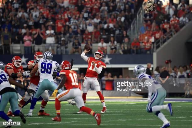 Alex Smith of the Kansas City Chiefs throws against the Dallas Cowboys in the second quarter at ATT Stadium on November 5 2017 in Arlington Texas