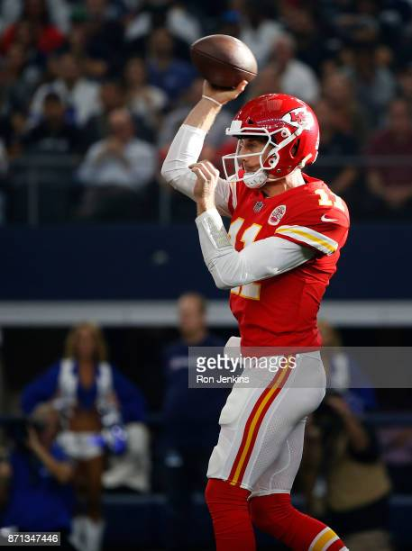 Alex Smith of the Kansas City Chiefs throws against the Dallas Cowboys during the first half at ATT Stadium on November 5 2017 in Arlington Texas