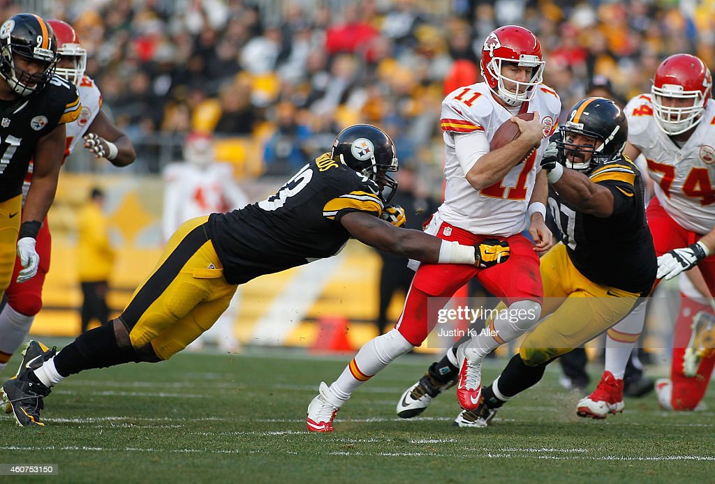 Alex Smith #11 of the Kansas City Chiefs tries to break through the defense of Jason Worilds #93 and Cameron Heyward #97 of the Pittsburgh Steelers during the third quarter at Heinz Field on December 21, 2014 in Pittsburgh, Pennsylvania.