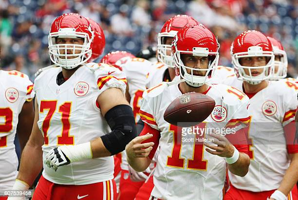 Alex Smith of the Kansas City Chiefs waits with his teammates on the field prior to the start of their game against the Houston Texans at NRG Stadium...