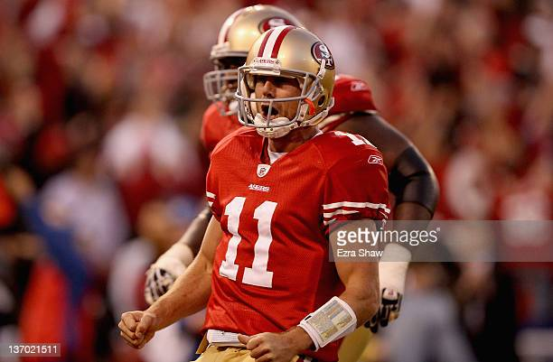 Alex Smith of the San Francisco 49ers celebrates after running in for a touchdown in the fourth quarter of the NFC Divisional playoff game against...