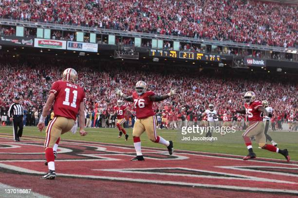 Alex Smith of the San Francisco 49ers celebrates his touchdown in the fourth quarter against the New Orleans Saints during the NFC Divisional playoff...