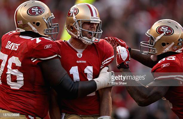 Alex Smith of the San Francisco 49ers celebrates his touchdown with teammates in the fourth quarter against the New Orleans Saints during the NFC...