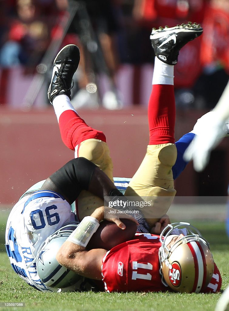 Alex Smith #11 of the San Francisco 49ers is sacked by Jay Ratliff #90 of the Dallas Cowboys at Candlestick Park on September 18, 2011 in San Francisco, California.