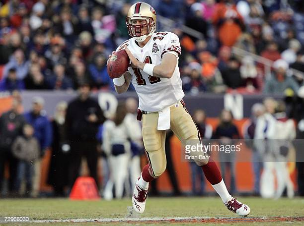 Alex Smith of the San Francisco 49ers passes the ball during the game against the Denver Broncos at Invesco Field at Mile High on December 31 2006 in...