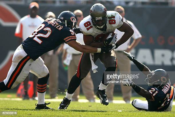 Alex Smith of the Tampa Bay Buccaneers runs with the ball against Hunter Hillenmeyer and Corey Graham of the Chicago Bears at Soldier Field on...