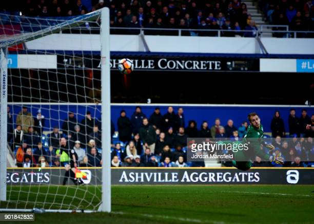 Alex Smithies of QPR dives but fails to save the shot from Ousseynou Cisse of MK Dons during The Emirates FA Cup Third Round match between Queens...