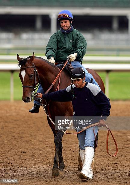 Alex Solis and Brother Derek are lead off the track by Angel Rangel after morning workouts in preparation for the 132nd Kentucky Derby May 1 2006 at...