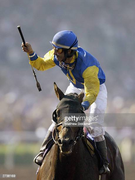 Alex Solis celebrates winning aboard horse Pleasantly Perfect in the $4 Million Breeders' Cup Classic Powered by Dodge part of the 2003 Breeders' Cup...