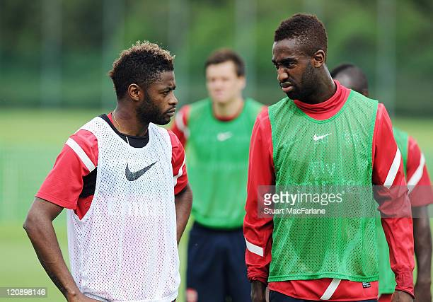 Alex Song and Johan Djourou of Arsenal during a training session at London Colney on August 12, 2011 in St Albans, England.