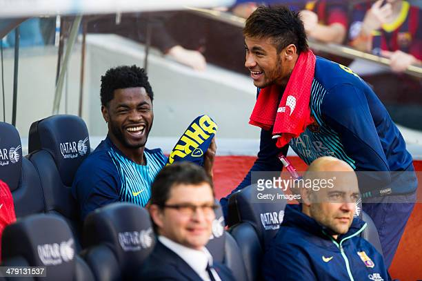 Alex Song and Neymar Santos Jr of FC Barcelona share a laugh on the bench during the La Liga match between FC Barcelona and CA Osasuna at Camp Nou on...