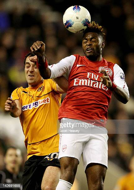 Alex Song of Arsenal beats Nenad Milijas in the air during the Barclays Premier League match between Wolverhampton Wanderers and Arsenal at Molineux...