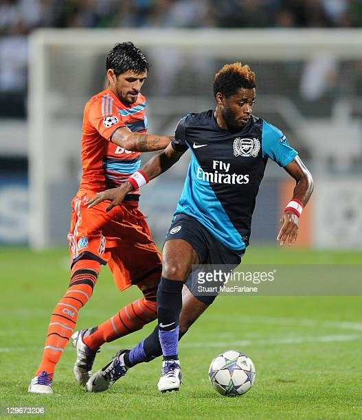 Alex Song of Arsenal breaks past AndrePierre Gignac of Marseille during the UEFA Champions League Group F match between Olympique de Marseille and...