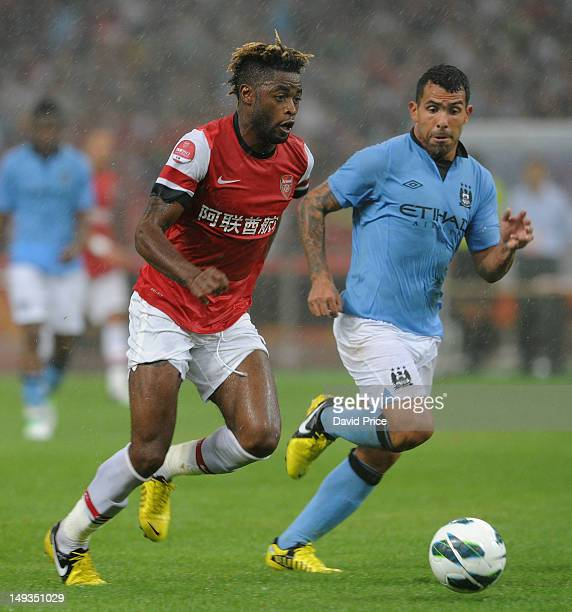 Alex Song of Arsenal FC takes on Carlos Tevez of Man City during the preseason Asian Tour friendly match between Arsenal and Manchester City at Birds...