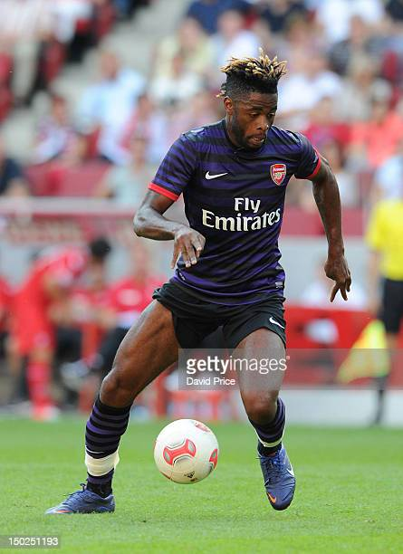 Alex Song of Arsenal in action against FC Cologne during a PreSeason Friendly game at Rhein Energie Stadium on August 12 2012 in Cologne Germany