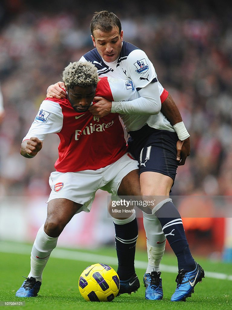 Alex Song of Arsenal is challenged by Rafael Van Der Vaart of Tottenham during the Barclays Premier League match between Arsenal and Tottenham Hotspur at the Emirates Stadium on November 20, 2010 in London, England.