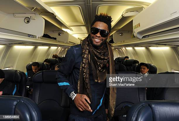 Alex Song of Arsenal poses on the plane at Luton Airport as they travel to Milan ahead of their UEFA Champions League Group match against AC Milan at...
