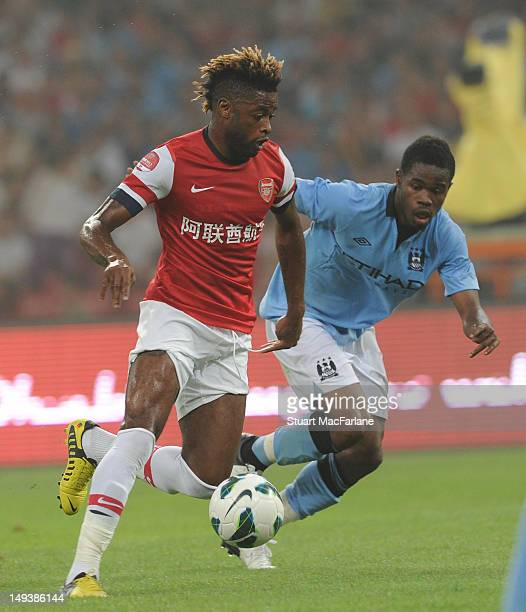 Alex Song of Arsenal takes on Abdul Razak of Manchester City during the preseason Asian Tour friendly match between Arsenal and Manchester City at...