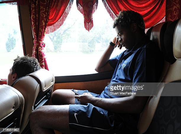Alex Song of Arsenal travels on the team coach to training at the Shah Alam Stadium on July 12 2011 in Shah Alam Malaysia
