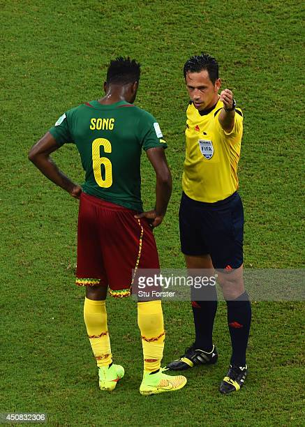 Alex Song of Cameroon is sent off after a red card by referee Pedro Proenca during the 2014 FIFA World Cup Brazil Group A match between Cameroon and...