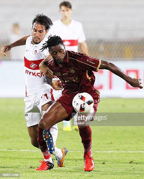 Alex Song of FC Rubin Kazan challenged by Ivelin Popov of FC Spartak Moscow during the Russian Premier League match between FC Rubin Kazan and FC...