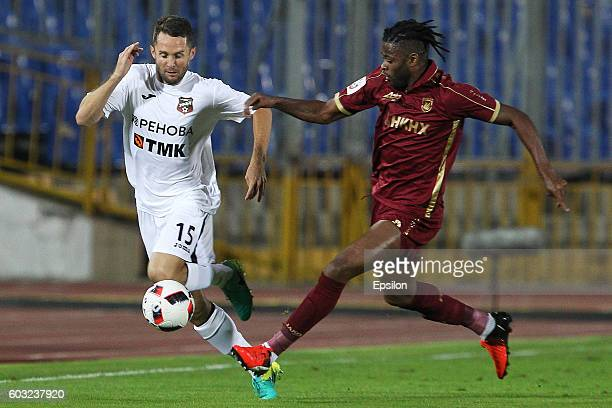 Alex Song of FC Rubin Kazan is challenged by Denys Kulakov of FC Ural Ekaterinburg during the Russian Premier League match between FC Rubin Kazan and...