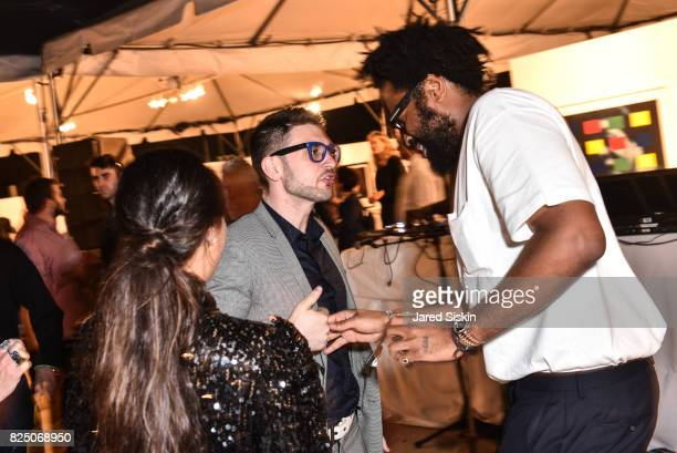 Alex Soros and Maxwell Osborne attend The 24th Annual Watermill Center Summer Benefit & Auction at The Watermill Center on July 29, 2017 in Water...