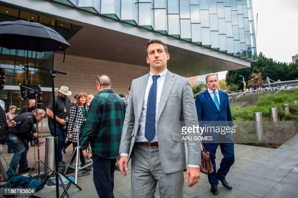 Alex Spiro leader of Elon Musk attorneys team leaves the US District Court Central District of California in Los Angeles on December 6 2019 Tesla...
