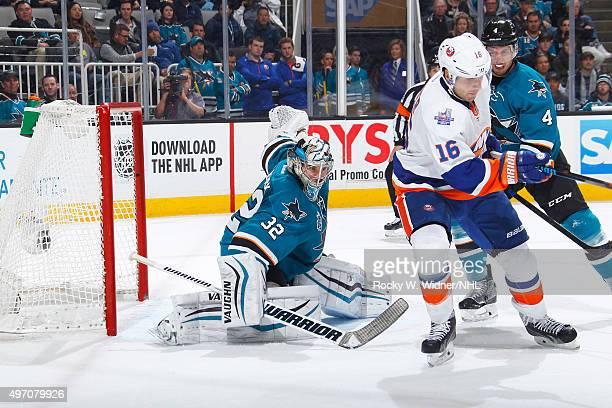 Alex Stalock and Brenden Dillon of the San Jose Sharks protect the net against Steve Bernier of the New York Islanders at SAP Center on November 10...