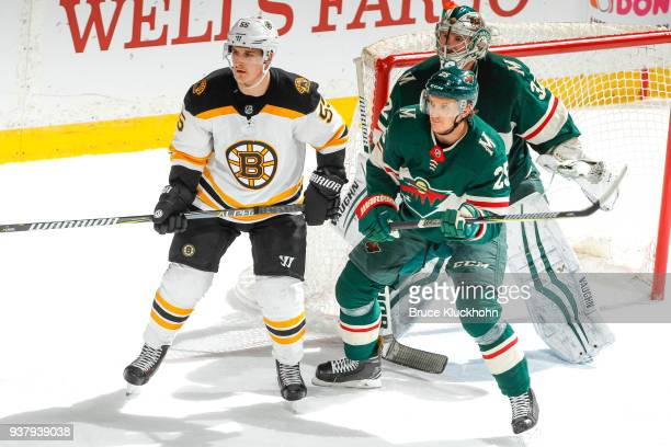 Alex Stalock and Jonas Brodin of the Minnesota Wild defend their goal against Noel Acciari of the Boston Bruins during the game at the Xcel Energy...