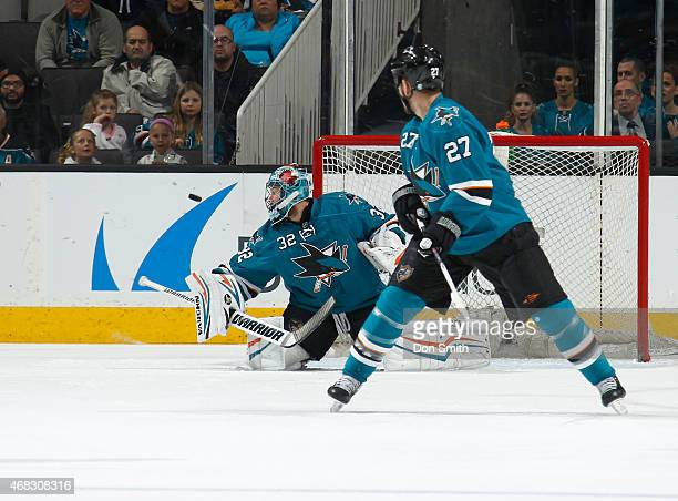 Alex Stalock and Scott Hannan of the San Jose Sharks protect the net against the Colorado Avalanche at the SAP Center on April 1 2015 in San Jose...