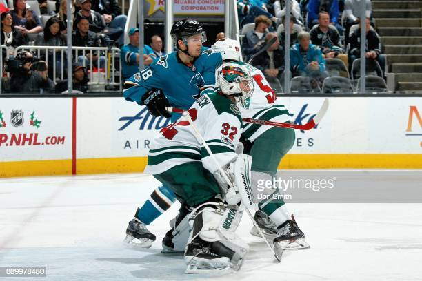 Alex Stalock and Zack Mitchell of the Minnesota Wild defend Tomas Hertl of the San Jose Sharks at SAP Center on December 10 2017 in San Jose...