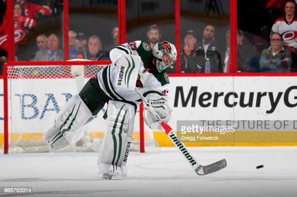 Alex Stalock of the Minnesota Wild comes out of the crease to play the puck during an NHL game against the Carolina Hurricanes on October 7 2017 at...