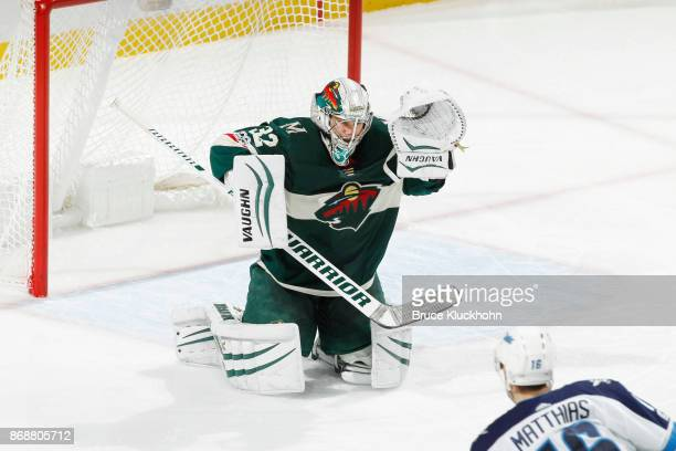 Alex Stalock of the Minnesota Wild defends his goal against the Winnipeg Jets during the game at the Xcel Energy Center on October 31 2017 in St Paul...