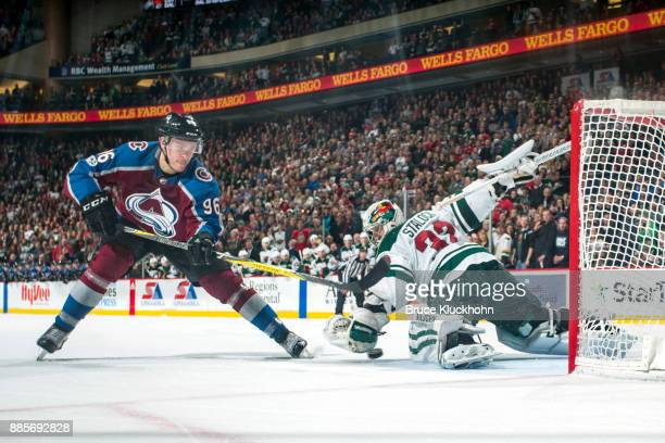 Alex Stalock of the Minnesota Wild makes a save against Mikko Rantanen of the Colorado Avalanche during the game at the Xcel Energy Center on...