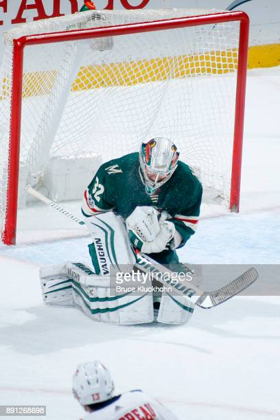 Alex Stalock of the Minnesota Wild makes a save against the Calgary Flames during the game at the Xcel Energy Center on December 12 2017 in St Paul...