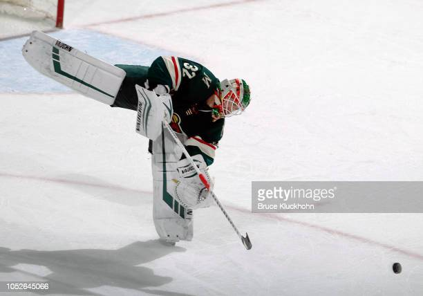 Alex Stalock of the Minnesota Wild plays the puck during a game between the Minnesota Wild and Tampa Bay Lightning at Xcel Energy Center on October...